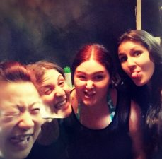 Group of female customers posing with funny faces together with Helen